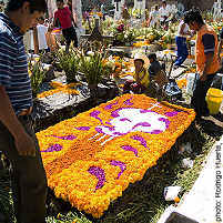 Mexican grave decorated with marigolds for Day of the Dead