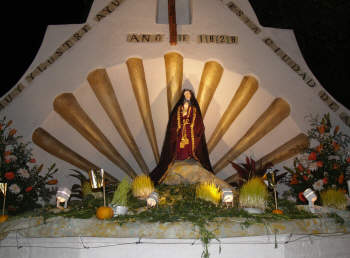 A public fountain decorated for Friday de Sorrows, Holy Week, Mexico