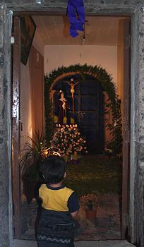 Boy admiring a home altar for the Virgen de Sorrows, Holy week, Mexico