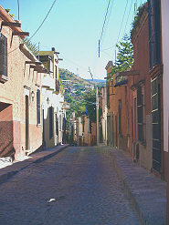 A typical narrow colonial street in San Miguel de Allende