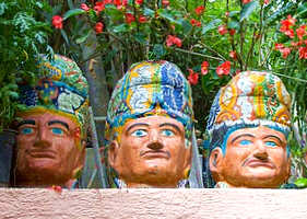 Huge ceramic masks adorn the gardens of the home of Toller Cranston in San Miguel de Allende